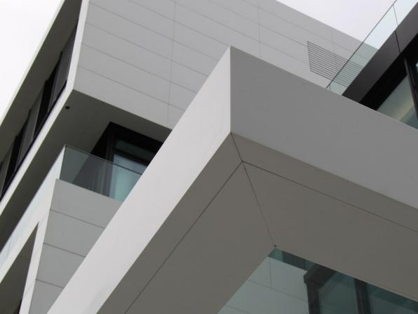 What are the benefits of façade cladding panels?